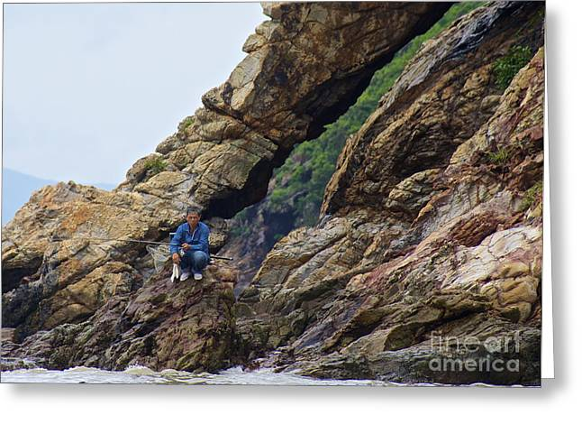 Greeting Card featuring the photograph Fisherman On Rocks  by Sarah Mullin