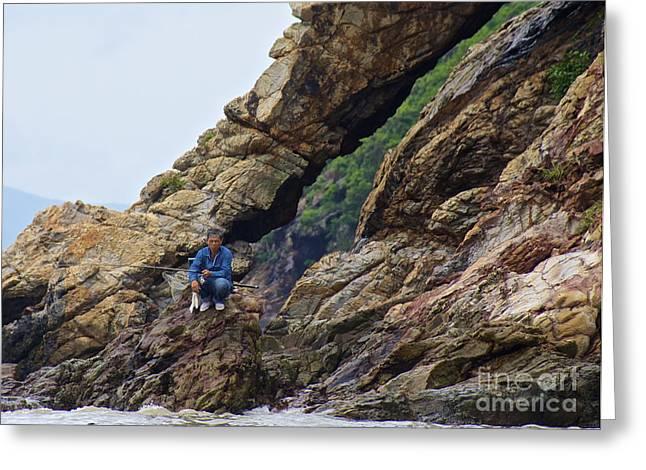 Fisherman On Rocks  Greeting Card