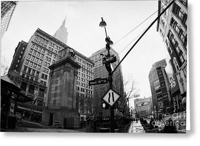fisheye shot of Herald Square Macys and Broadway from 35th Street in the rain and empire state build Greeting Card