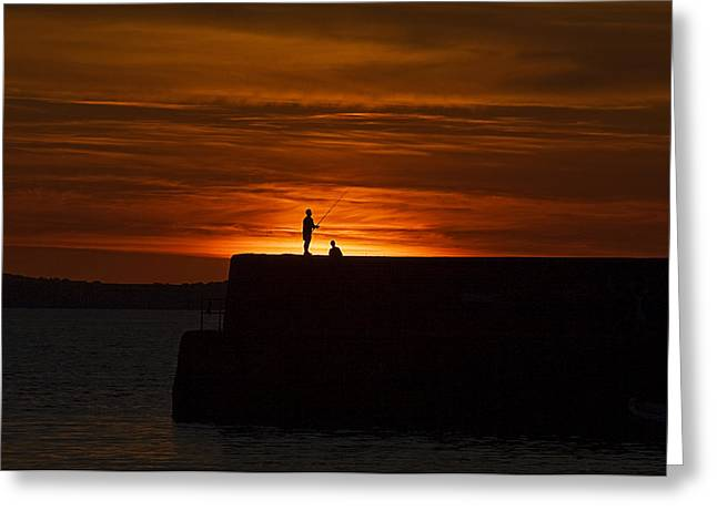 Fishing As Sunset Greeting Card by Tony Reddington