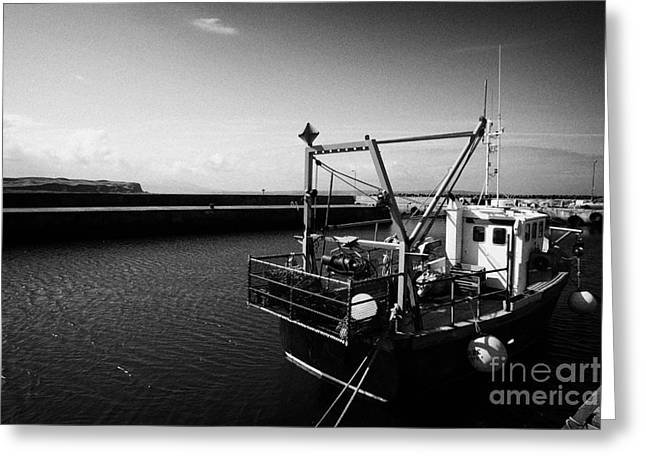 fishing boat tied up in rathlin harbour Rathlin Island northern ireland Greeting Card