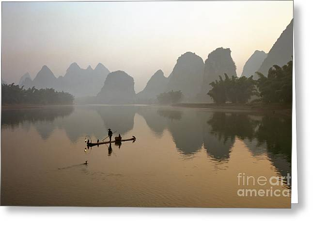 Fishing With Cormorant On Li River Greeting Card by King Wu