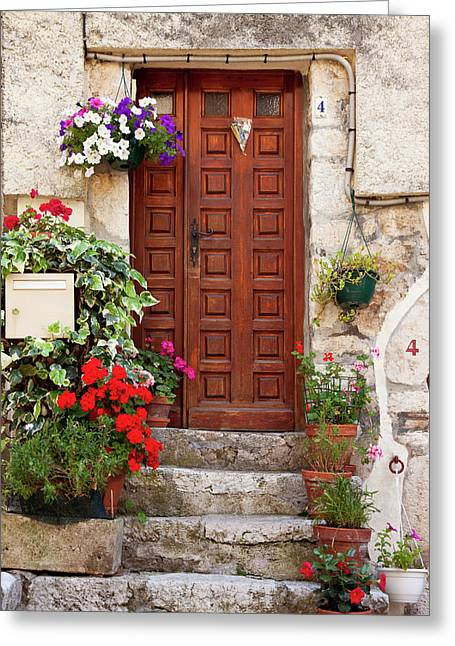 Flowers Surround The Front Door To Home Greeting Card by Brian Jannsen