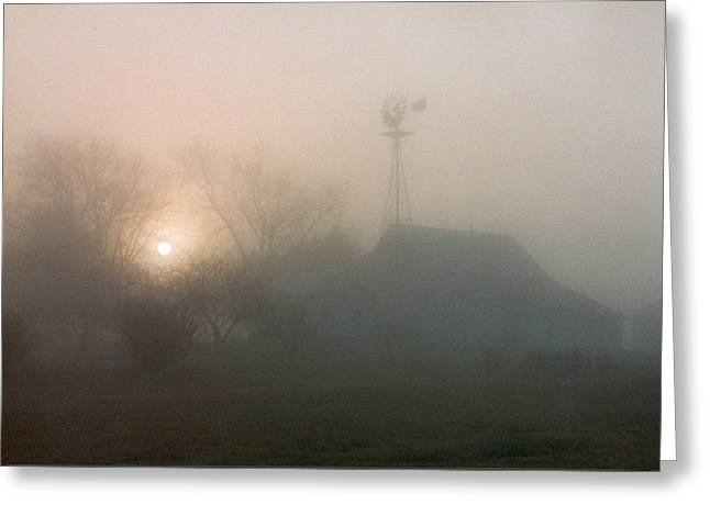 Foggy Sunrise Over Barn Greeting Card by Peg Toliver