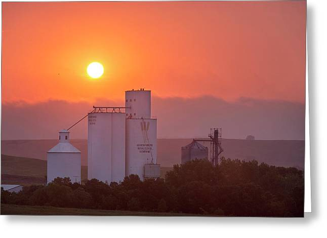 Foggy Sunrise Over Grain Elevator Greeting Card by Chuck Haney
