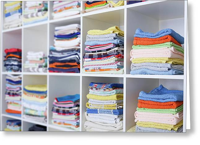 Folded Towels On Shelves Greeting Card