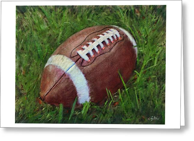 Football On Field Greeting Card by Craig Tinder