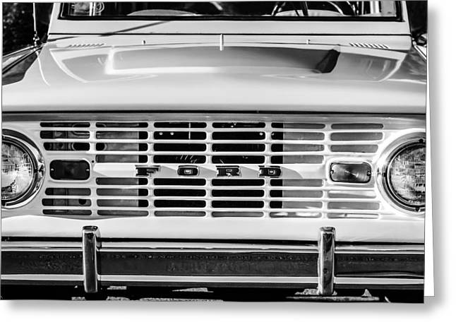 Greeting Card featuring the photograph Ford Bronco Grille Emblem -0014bw by Jill Reger