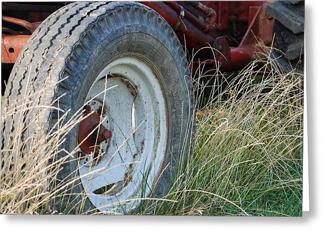 Ford Tractor Tire Greeting Card by Jennifer Ancker
