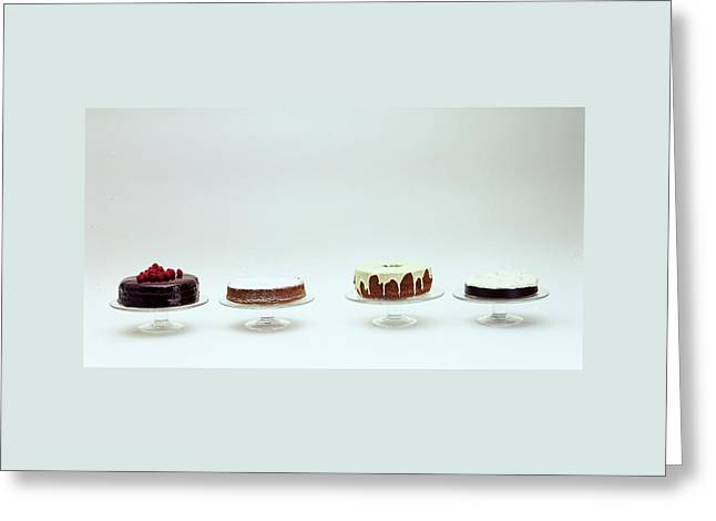 Four Cakes Side By Side Greeting Card by Romulo Yanes