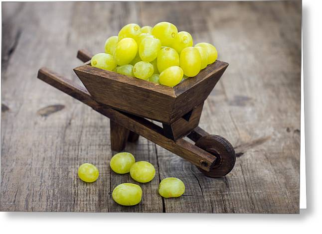 Fresh Green Grapes In A Wheelbarrow Greeting Card by Aged Pixel