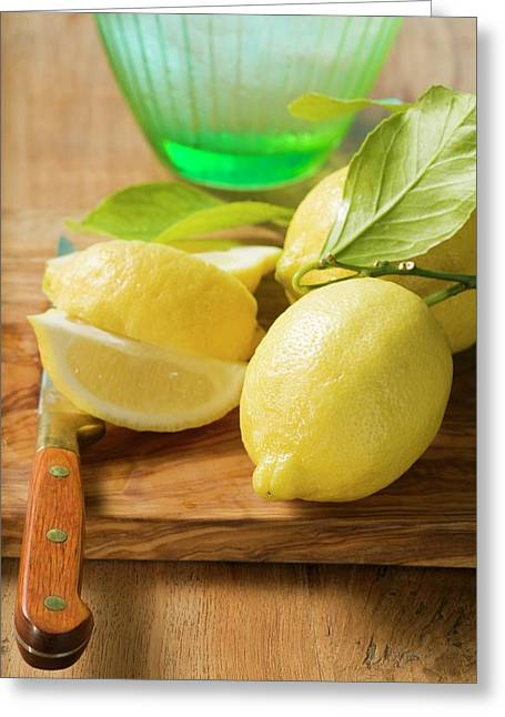 Fresh Lemons With Leaves In Front Of Water Jug Greeting Card