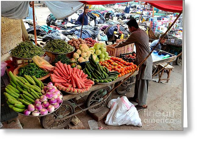 Fruit And Vegetable Seller Tends To His Cart Outside Empress Market Karachi Pakistan Greeting Card by Imran Ahmed