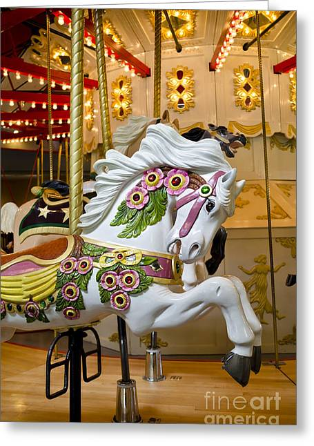 Greeting Card featuring the photograph Galloping White Beauty - Vintage Carousel Horse by Maria Janicki