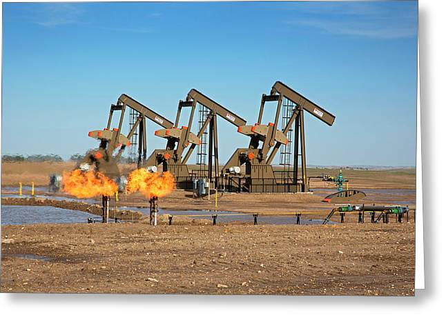 Gas Flares And Pumps At An Oil Field Greeting Card by Jim West