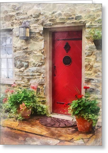 Geraniums By Red Door Greeting Card by Susan Savad