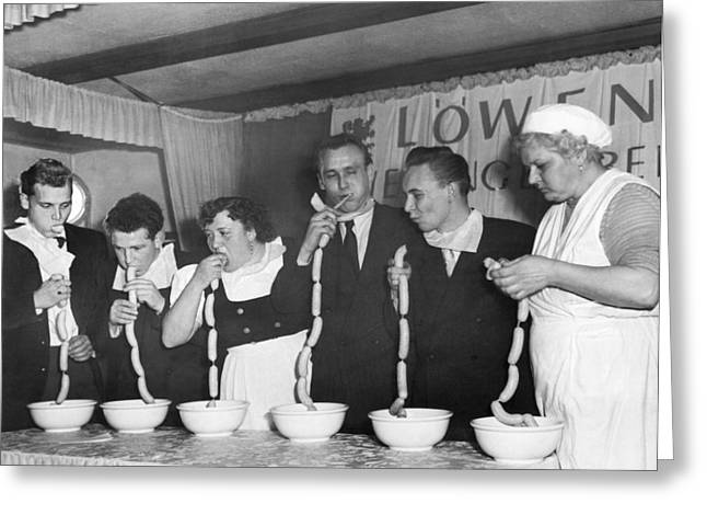 German Sausage Eating Contest Greeting Card by Underwood Archives