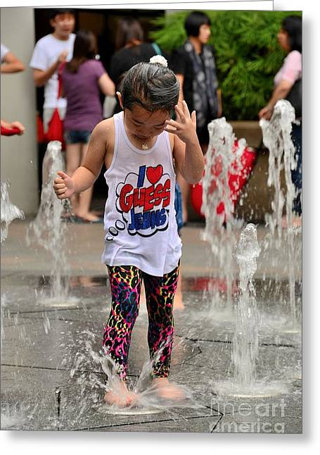 Girl Child Plays With Water At Fountain Singapore Greeting Card