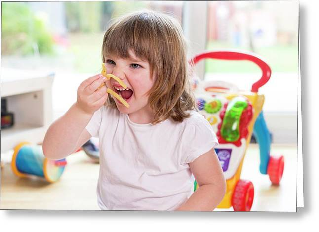 Girl Eating French Fries Greeting Card by Aberration Films Ltd