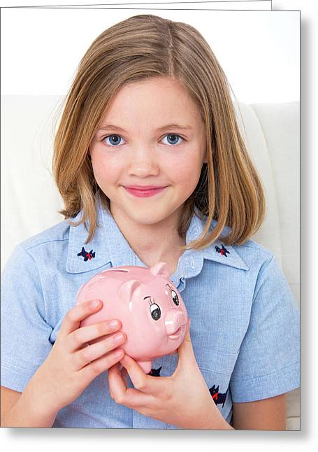 Girl Holding A Piggy Bank Greeting Card by Lea Paterson