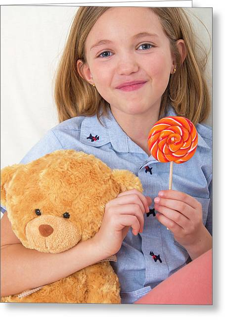 Girl Holding Lollypop And Teddy Bear Greeting Card