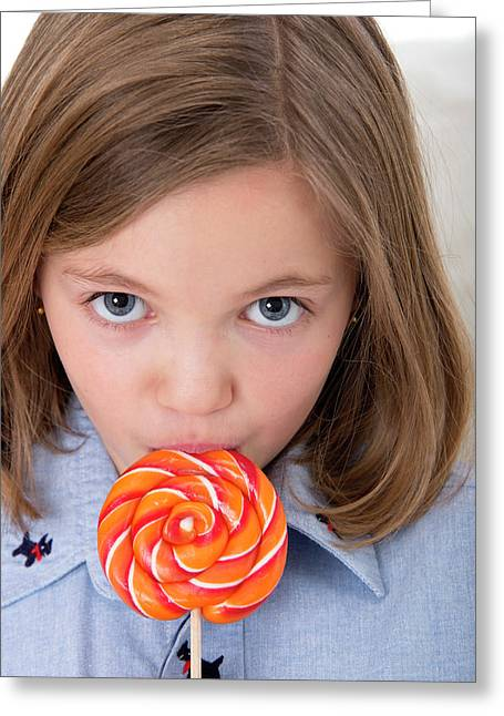 Girl Licking A Lollypop Greeting Card by Lea Paterson