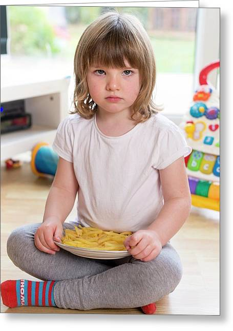 Girl Sitting On Floor With French Fries Greeting Card by Aberration Films Ltd