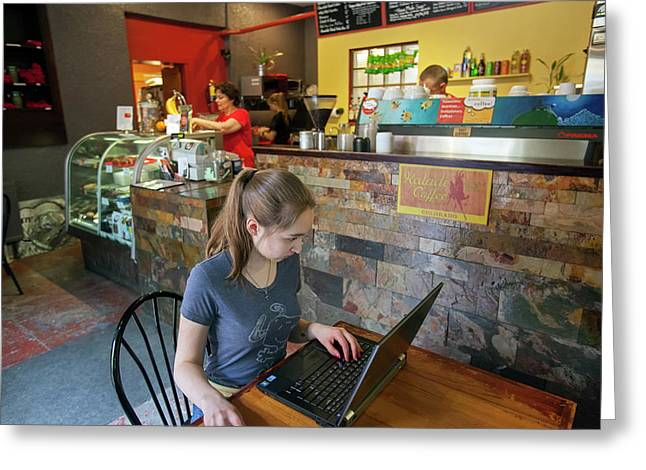 Girl Using A Laptop In A Cafe Greeting Card