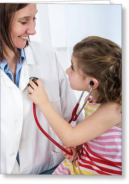 Girl Using A Stethoscope On Doctor Greeting Card