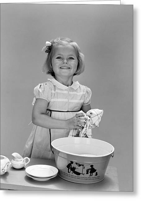 Girl Washing Dishes And Smiling, C.1940s Greeting Card by H. Armstrong Roberts/ClassicStock