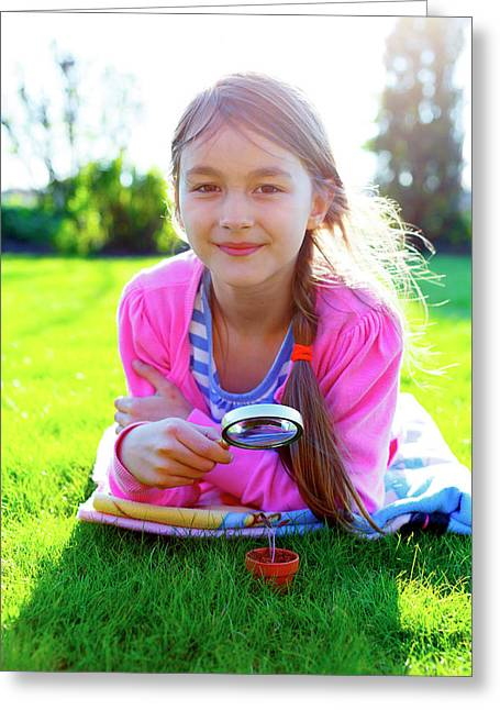 Girl With A Magnifying Glass And Seedling Greeting Card