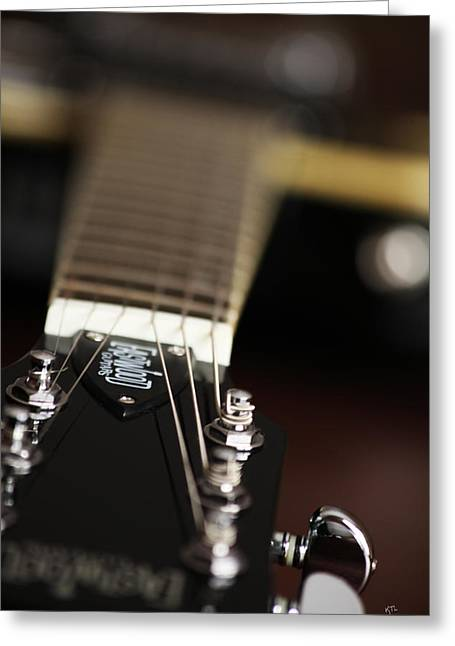 Glimpse Of A Guitar Greeting Card by Karol Livote