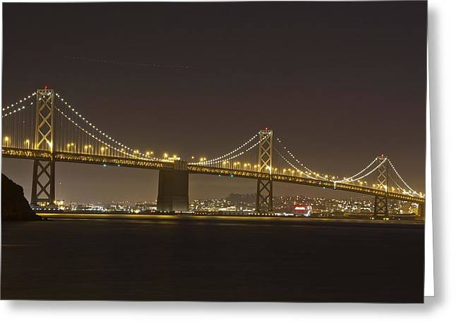 Golden Night On The Bay Greeting Card by Miguel  Uribe
