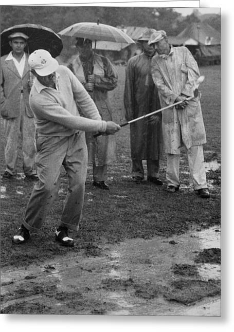 Golfer Playing In The Rain Greeting Card by Underwood Archives