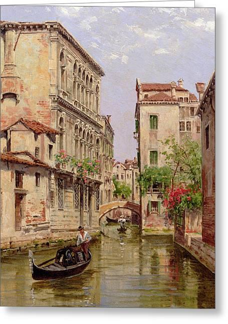 Gondolas On A Venetian Canal Greeting Card by Antonietta Brandeis