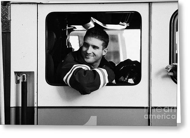 good looking male FDNY fireman looks back out of window of fire truck new york city Greeting Card