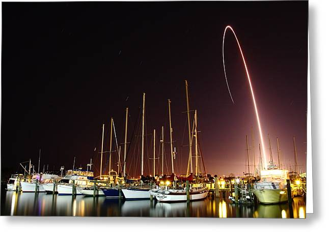 Gps Launch Over The Marina Greeting Card by John Moss