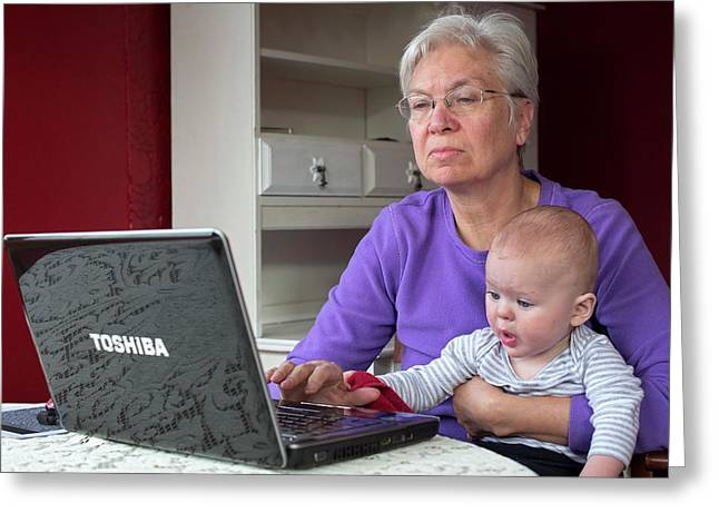 Grandmother And Baby Using A Computer Greeting Card by Jim West