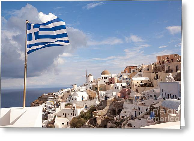 Greek National Flag Waving Over Oia - Santorini - Gr Greeting Card by Matteo Colombo