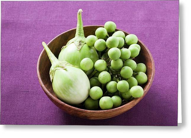 Green Baby Aubergines In Wooden Bowl Greeting Card