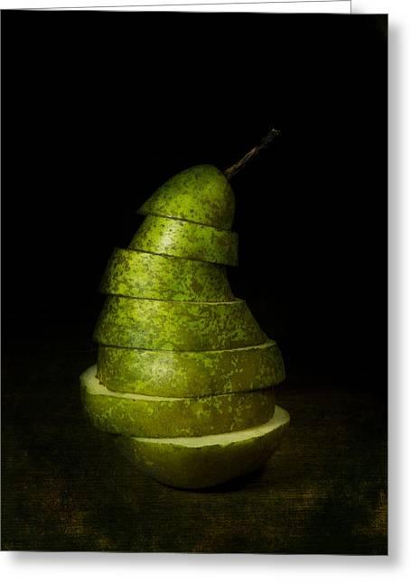Green Sliced Pear Greeting Card by Jaroslaw Blaminsky