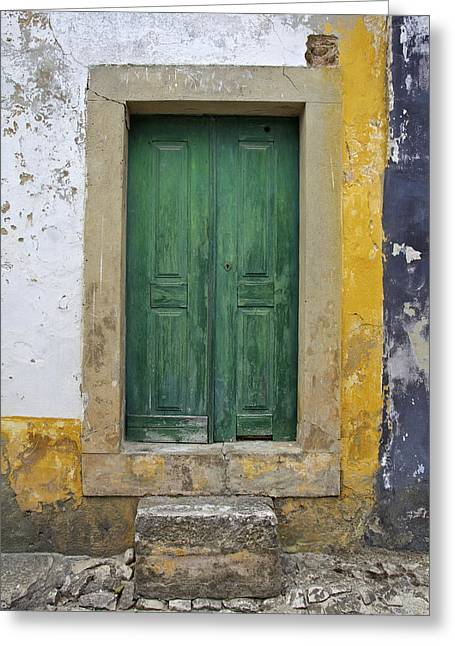 Green Wood Door With Hand Carved Stone Against A Texured Wall In The Medieval Village Of Obidos Greeting Card by David Letts