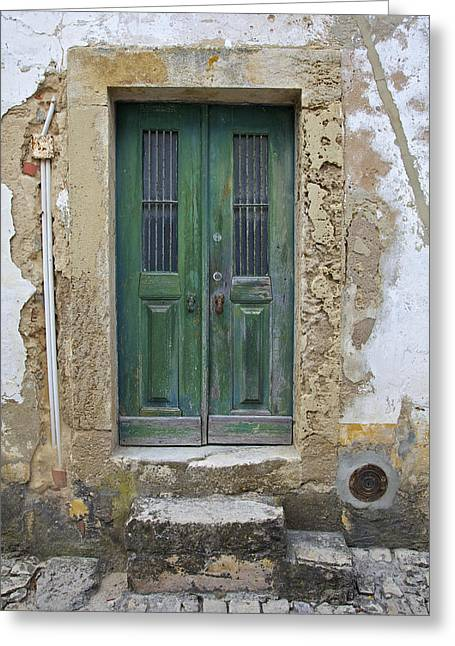 Green Wood Door With Hand Carved Stone In The Medieval Village Of Obidos Greeting Card by David Letts