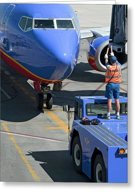 Ground Crew Directing Jet Airliner Greeting Card by Jim West