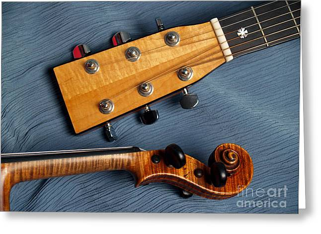 Guitar And Violin Heads On Blue Greeting Card by Anna Lisa Yoder