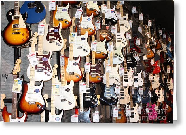 Guitar Wall Of Fame Greeting Card by John Telfer