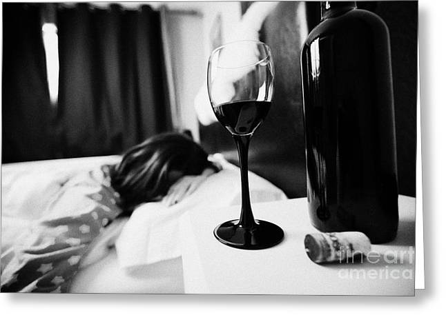 Half Full Glass Of Wine On Bedside Table Of Early Twenties Woman In Bed In A Bedroom Greeting Card