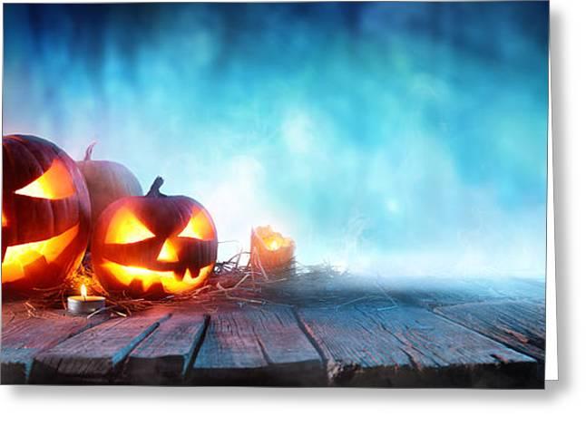 Halloween Pumpkins On Wood In A Spooky Greeting Card by Romolo Tavani
