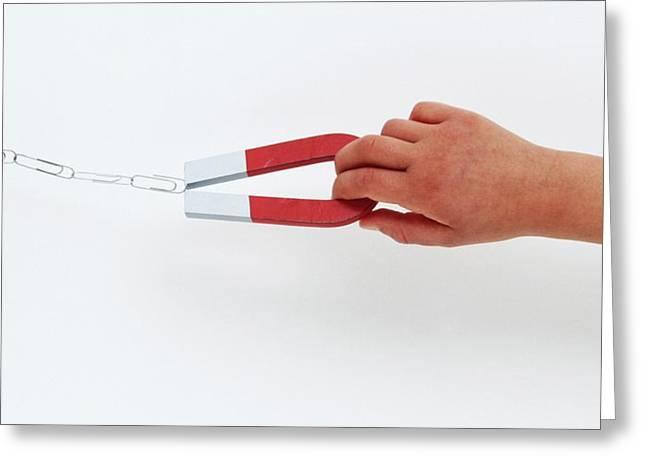 Hand Holding Horseshoe Magnet Greeting Card by Dorling Kindersley/uig