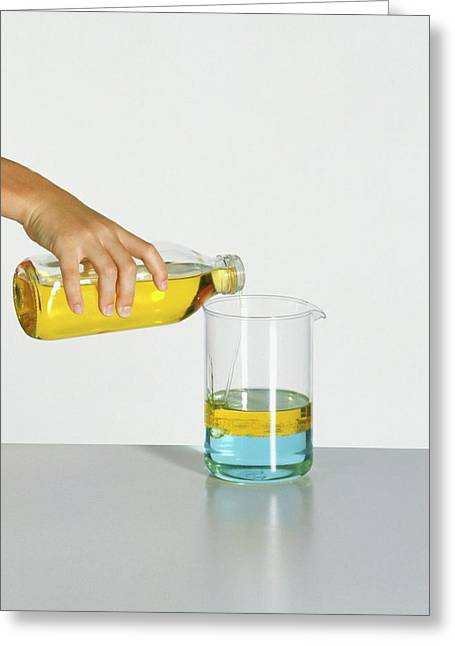 Hand Pouring Cooking Oil Over Water Greeting Card by Dorling Kindersley/uig